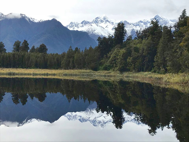 Mirror reflection on Lake Matheson of Aoraki Mt. Cook