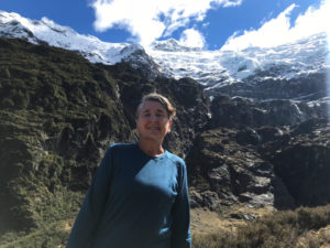 Mary at the top of the Rob Roy Glacier walk, with a hanging glacier behind her