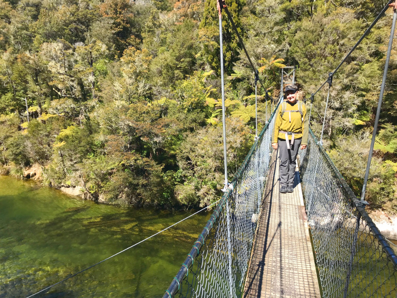 Mary on a swing bridge in Abel Tasman National Park