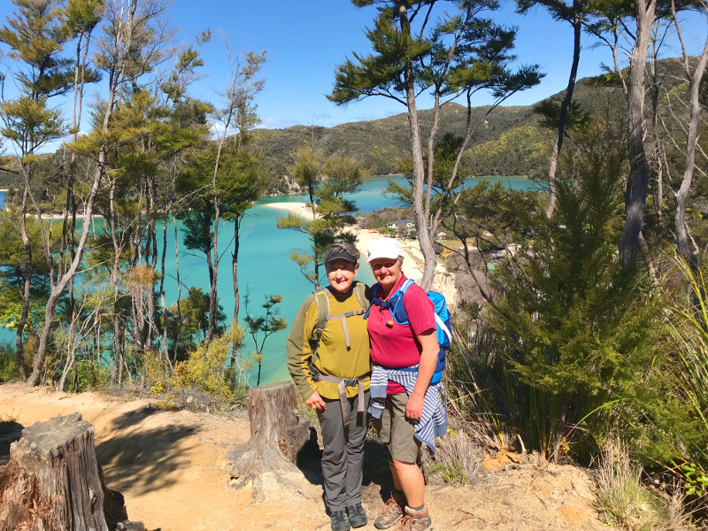 Mary with local Yvonne in front of turquoise waters in Abel Tasman National Park