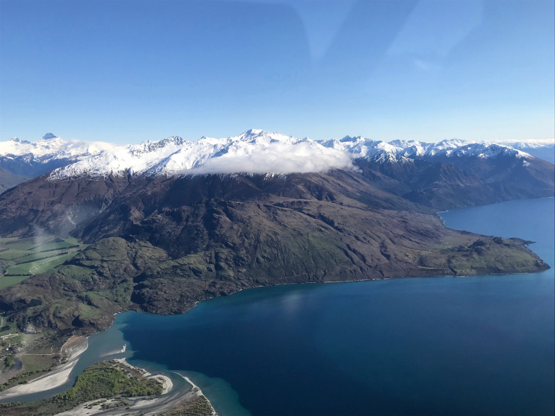 view from airplane over Lake Wanaka and Southern Alps on the way to Milford Sound