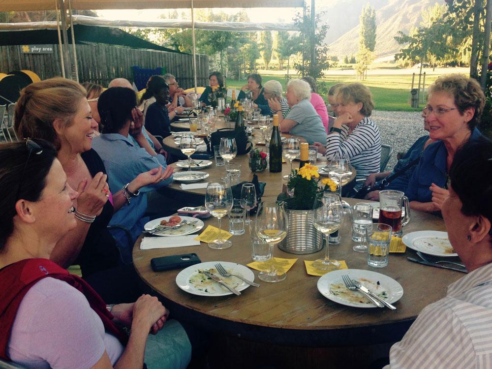 women enjoying a vineyard dinner