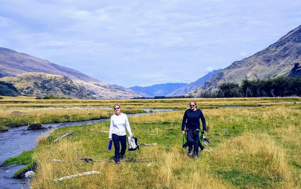 two women hiking in wilderness