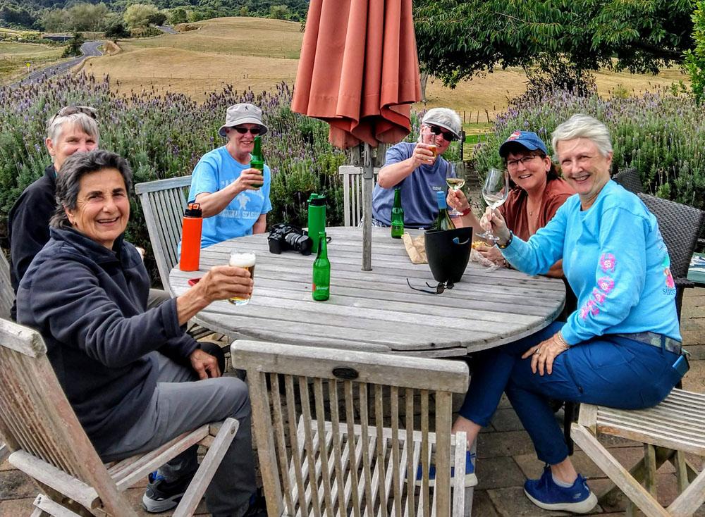 women gathered around table enjoying each others company